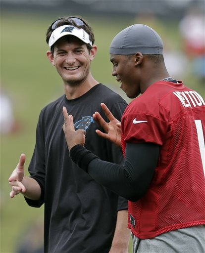 """Dorsey handing off some West Coast culture to Cam at a recent Panthers' practice."" (Photo by Chuck Burton/AP)"