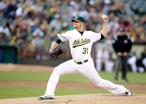 Jon Lester, dealing... (photo by Ezra Shaw)
